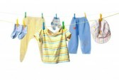 11784299-baby-clothes-drying-on-a-rope-isolated-on-white-background-1-.jpg