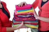 18685996-women-holding-pile-of-ironed-and-colorful-clothes.jpg